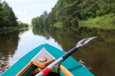 Kayak on a small river — Stockfoto