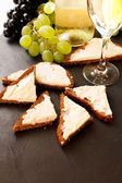 Toast with cheese and wine — Stock Photo