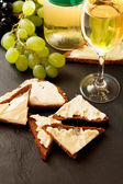 Toast with cheese and wine — Photo