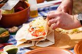 Chef making tortilla — Stock Photo