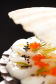 Scallops presented on a scallop shell — Stock Photo
