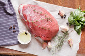 Raw veal meat with spice — Stock Photo