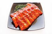 Pork ribs in sauce — Stock Photo