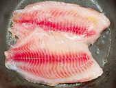 Frying fish — Stock Photo