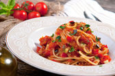 Spaghetti with tomato sauce and vegetable — Stock Photo