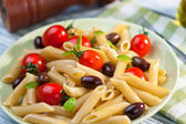Pasta with fresh tomatoes and olives — Stock Photo