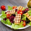 Fresh mixed salad with grilled cheese — Stock Photo #14903269