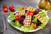 Fresh mixed salad with grilled cheese — Stock Photo
