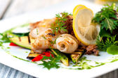 Baked squids on plate — Stock Photo