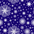 Christmas snowflakes on seamless pattern — Imagen vectorial