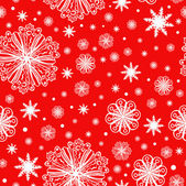 Christmas snowflakes on red seamless pattern — Stock Vector