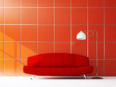Sofa near the red wall — Stock Photo