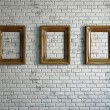 Three empty wooden frames — Stock Photo #24275559