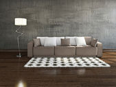 Brown sofa near the wall — Stock Photo