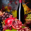 Beautiful still life with wine glasses, grapes, pomegranate — Stock Photo