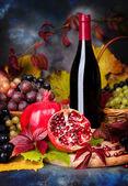 Beautiful still life with wine glasses, grapes, pomegranate — Stock Photo