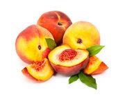 Tasty, juicy peaches isolated on white background — Stock Photo
