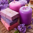 Handmade soap, candle and lilac — Stok fotoğraf