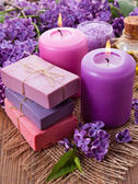 Handmade soap, candle and lilac — Stock Photo