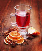Glass of mulled wine on the table in dark wood — Stock Photo