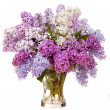 Lilacs in a glass vase — Stock Photo