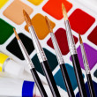 A set of brushes on the background of acrylic and watercolor — Foto de Stock