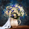 Chamomile and cornflowers. Flowers in a vase on the table — Stock Photo #29443143