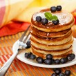 Fresh pancakes with blueberries and honey — Stock Photo