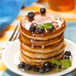 Fresh pancakes with blueberries and honey — 图库照片