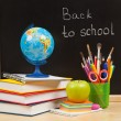 Stock Photo: Back to school. School board and books and apple