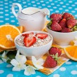 Healthy breakfast. Rolled oats, strawberries and oranges in a be — Stock Photo