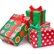 Boxes with gifts tied with red ribbon and bows isolated on white — Stock Photo