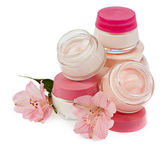 Cosmetic cream for make-up and fresh flowers isolated on white b — Stock Photo