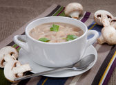 Delicious soup with mushrooms in a bowl on the table — Stock Photo
