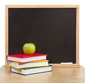 Back to school. School board and books and apple isolated — Stock Photo