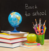 Back to school. School board and books and apple — Stock Photo