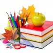 School concept - books, leaves, apple and stationery isolated on — Stock Photo