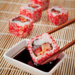 The concept of Japanese food - sushi and soy sauce on the mat — Стоковое фото