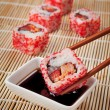 The concept of Japanese food - sushi and soy sauce on the mat — Stok fotoğraf