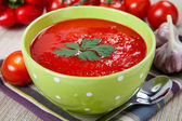 Tasty and healthy tomato soup and vegetables on the table — Stock Photo