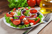 The Greek and Italian food - fresh vegetable salad on the table — Stock Photo
