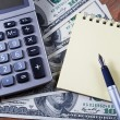 Stock Photo: Concept - business.Calculator, money, notebook and pen on ta