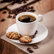 Stock Photo: Cup of coffee and cookies on the table