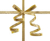 The concept of a gift - a golden bow and ribbon isolated on whit — Stock Photo
