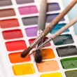 Watercolor paints and brush on the table  — Stock Photo