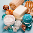 Sea salt, shells, sponge and cream on the table — Stock Photo