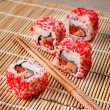 Fresh sushi on a mat on the table — Stock Photo
