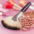 Powder and brush for makeup on the table — Stok fotoğraf