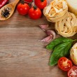 Italian cuisine. Vegetables, oil, spices and pasta on the table — Foto Stock