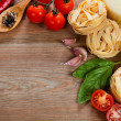 Italian cuisine. Vegetables, oil, spices and pasta on the table — Stok fotoğraf